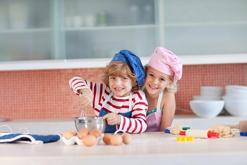 Little Boy and Girl Cooking in Kitchen